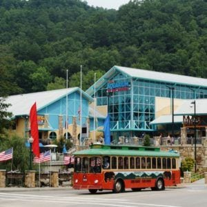 A Gatlinburg trolley parked in front of Ripley's Aquarium of the Smokies.