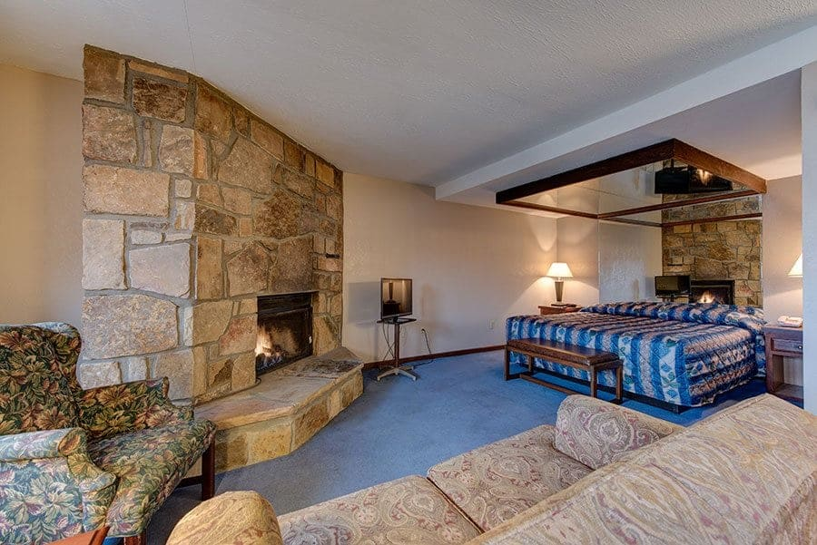 fireplace and living area in sidney james hotel suite