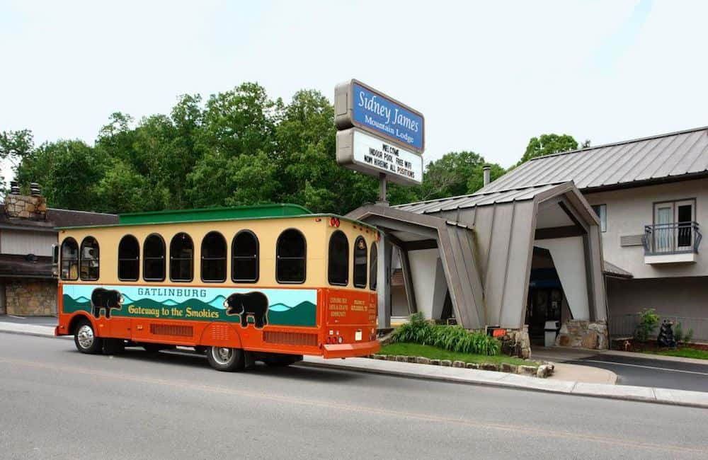 The Gatlinburg Trolley in front of Sidney James Mountain Lodge