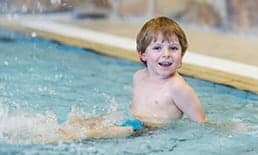 small child enjoying indoor pool at Sidney James