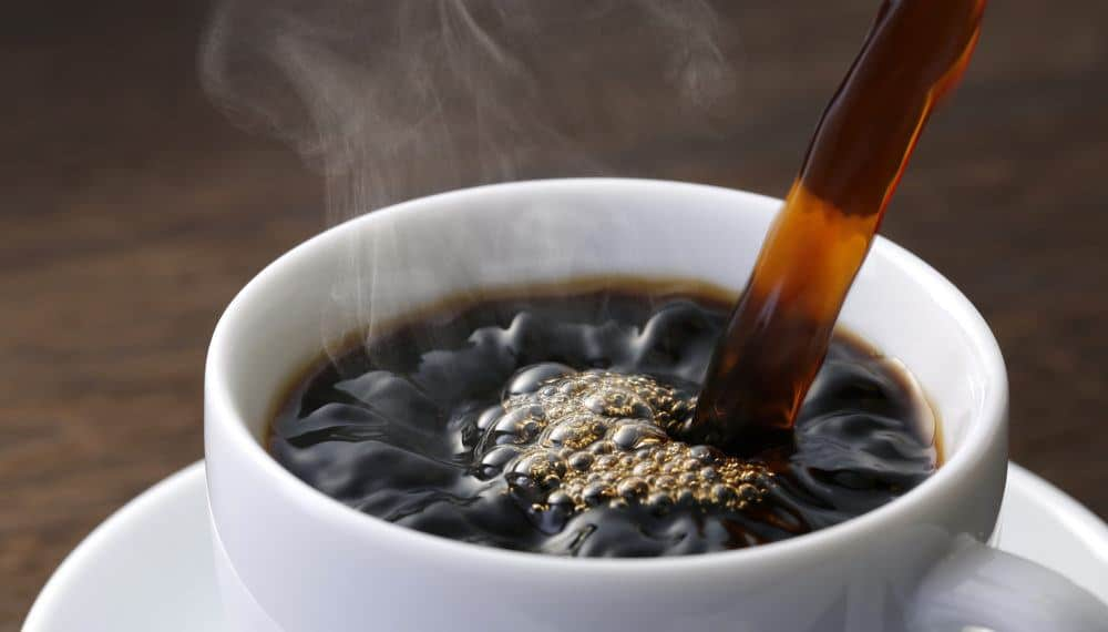 coffee being poured in a cup